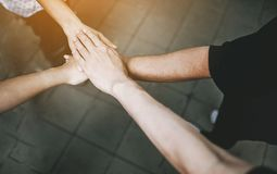 Teamwork With our arms and hands. stock photography