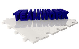 Teamwork over a puzzle Royalty Free Stock Images