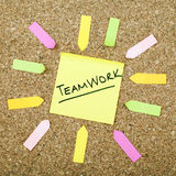Teamwork. Paper on cork noticeboard Royalty Free Stock Images