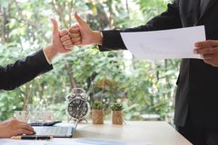 Success businessman partners making fist bump and thumbs up show royalty free stock images