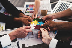 Teamwork of partners. Concept of integration and startup with puzzle pieces stock photos