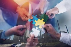 Teamwork of partners. Concept of integration and startup with puzzle pieces. double exposure Stock Image