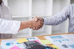 Teamwork partnership meeting concept, Business handshake after discussing good deal of Trading contract for both companies and royalty free stock photo
