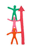 Teamwork plasticine figurines. Isolated on white background Royalty Free Stock Photos