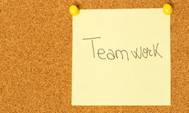 Teamwork post-it on a coarkboard background Royalty Free Stock Photo