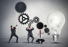 Teamwork powering an idea Stock Image