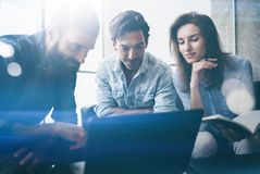 Teamwork process concept.Young coworkers team work with new startup project in office.Horizontal, blurred background. Teamwork process concept.Young coworkers Stock Image