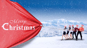 Teamwork pull christmas banner Stock Photo