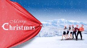 Teamwork pull christmas banner Stock Photo