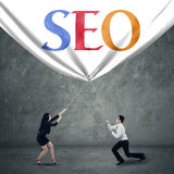 Teamwork pulling SEO banner Stock Photo