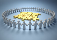 Teamwork and puzzle. Icon people holding hands and forming a circle around a golden puzzle Stock Image