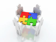 Teamwork puzzle Stock Images