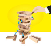 Teamwork:Puzzle game. A team are trying to get success in a puzzle game Royalty Free Stock Image