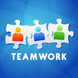 Teamwork and puzzle pieces with person signs, flat design Stock Photo