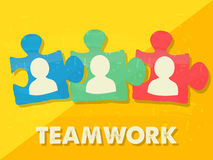 Teamwork and puzzle pieces with person signs, grunge flat design Royalty Free Stock Photography