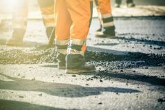 Teamwork on road construction Stock Images