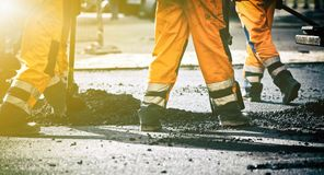 Teamwork on road construction Stock Photography