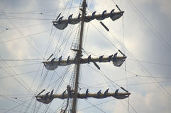 Teamwork on sailing ship Stock Photos