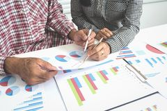 Teamwork of senior business man and woman analysis data. stock images