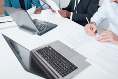 Teamwork. Signing contracts business and finance. Business team making deals and signing contracts. Discussing finance documents and making notes during meeting royalty free stock photos