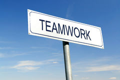 Teamwork signpost. White metal signpost with Teamwork word over blue sky royalty free stock photos