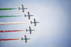 Teamwork on the sky. Frecce Tricolori in action. Royalty Free Stock Images