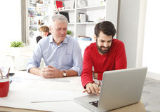 Teamwork in small architect studio Stock Image