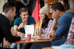 Teamwork socializing and studying for college exam Royalty Free Stock Photos