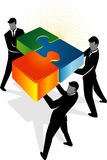 Teamwork Solutions. Conceptual illustration of businessman placing a large jigsaw Stock Photo