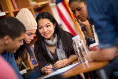Teamwork of students working on task together Royalty Free Stock Photos