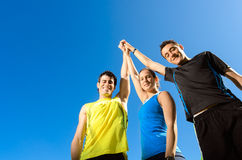 Teamwork success. Young team with two men and woman, celebrating victory and achievements Royalty Free Stock Photography