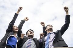 Teamwork and success concept, group of happy business people celebrating and making high hand to sky after achieving the highest. Of target stock images