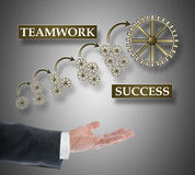 Teamwork success concept levitating above a hand Royalty Free Stock Photography