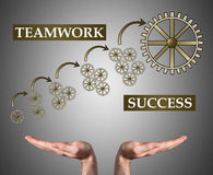 Teamwork success concept sustained by open hands Stock Photo