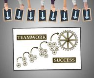 Teamwork success concept on a whiteboard. Hands holding writing slates with arrows pointing on teamwork success concept stock photography