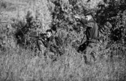 Teamwork and support. Activity for real men concept. Hunters gamekeepers looking for animal or bird. Hunting with. Friends. Hunters friends enjoy leisure royalty free stock photos