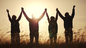 teamwork. team community hold hands together silhouette at sunset unity. group of people hands. teamwork a workers