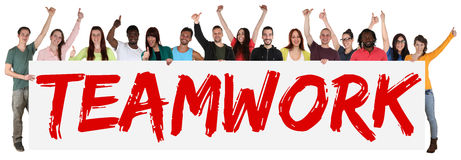 Teamwork team group of young multi ethnic people holding banner Royalty Free Stock Photo