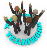 Teamwork - Team Members in Circle. Four diverse team members cheering in a circle surrounded by the word Teamwork Royalty Free Stock Photos