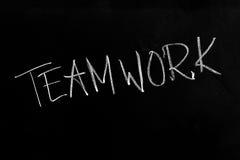 Teamwork Text on Blackboard. Handwritten chalk text Teamwork on the blackboard stock photo
