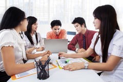 Teamwork with their leader in office Stock Images