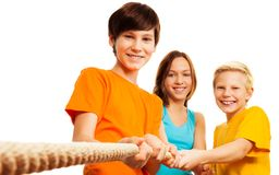Teamwork - three kids stock images