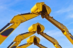 Teamwork. Three pairs of excavator buckets joining together stock photo