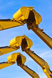 Teamwork. Three pairs of excavator buckets joining together stock photography