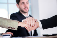 Teamwork. Three successful business people sitting in the office Stock Images