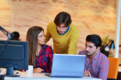 Teamwork. Three young architects working on a project royalty free stock images