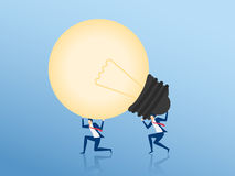 Teamwork to success concept. Businessman Cooperate carrying big light bulb idea. Stock Photography
