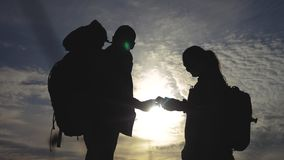 Teamwork tourism navigation concept. Happy family hikers silhouette in nature looking in lifestyle a smartphone. Navigation path. Man and woman with backpacks stock video footage