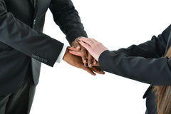 Teamwork. Two business people put hands together for teamwork Royalty Free Stock Image