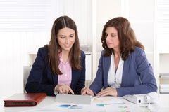 Teamwork: two business woman working together. Stock Image